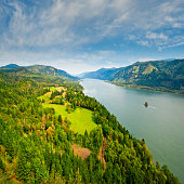 The Columbia Gorge is a canyon of the Columbia River which forms the border between the states of Oregon and Washington.  The canyon is up to 4,000 feet deep in places and stretches for over 80 miles as the river winds westward through the Cascade Range.  This scene of the Columbia River was taken from Cape Horn near Washougal, Washington State, USA.