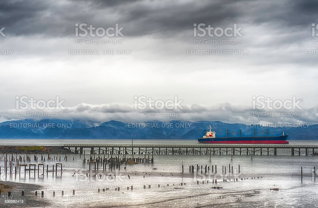 Columbia River under stormy skies and freighter stock photo