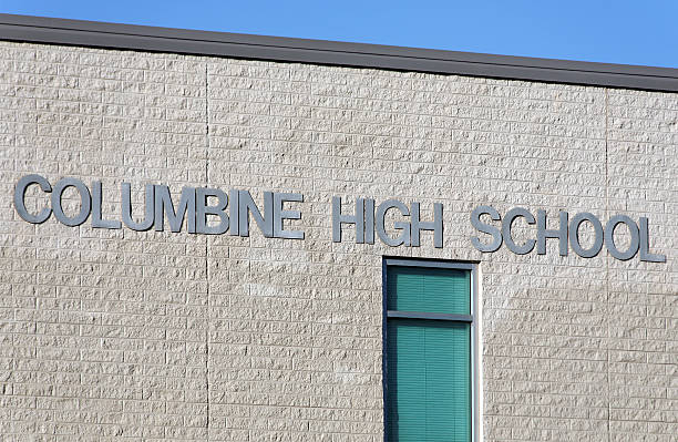 Columbine High School Jefferson County, Colorado, USA aa October 7, 2012: A sign at Columbine High School. Columbine High School was the site of one of the worst school shootings in United States history on April 20, 1999. mass murder stock pictures, royalty-free photos & images
