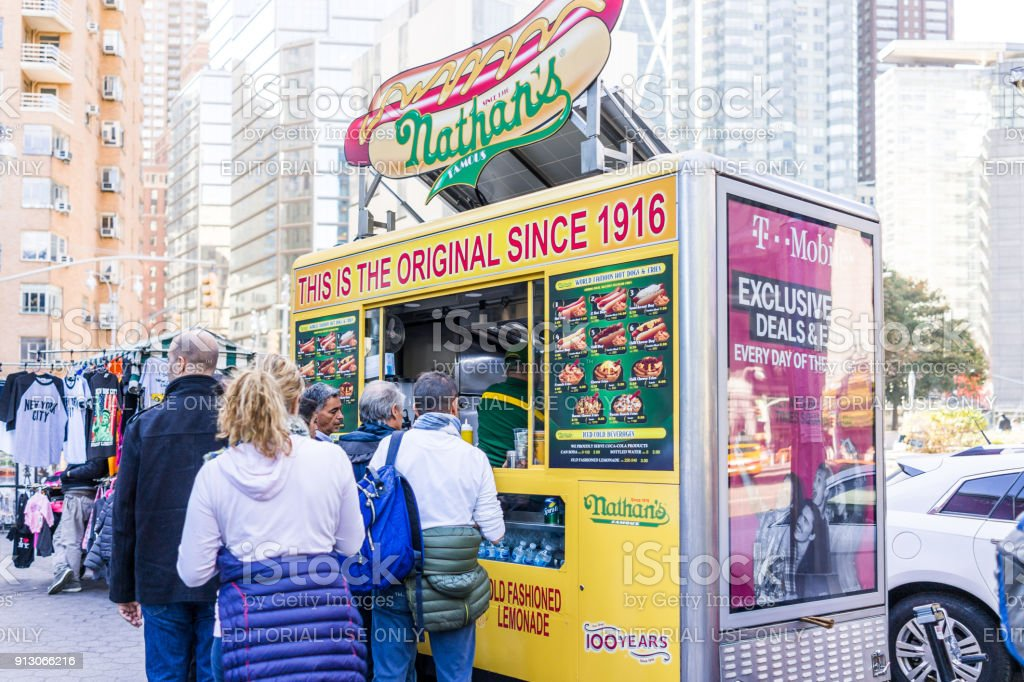 Columbus Circle In Midtown Manhattan NYC Nathans Hot Dog Food Truck Stand With Sign