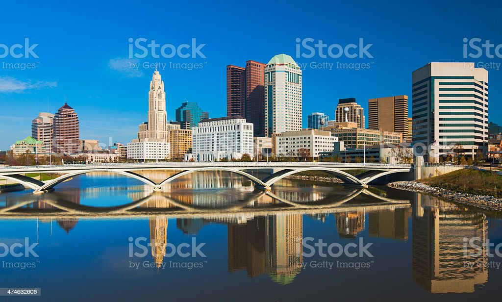 Columbus downtown skyline and bridge with mirror-like reflection stock photo