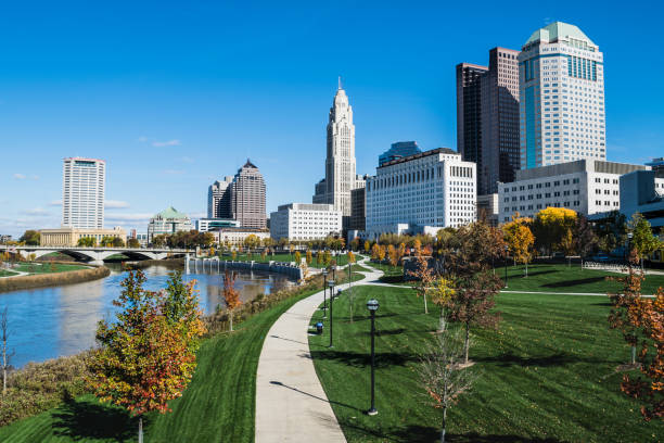 Columbus, Ohio skyline and the Scioto River A view of downtown Columbus and the Scioto Mile looking north into the city. ohio stock pictures, royalty-free photos & images