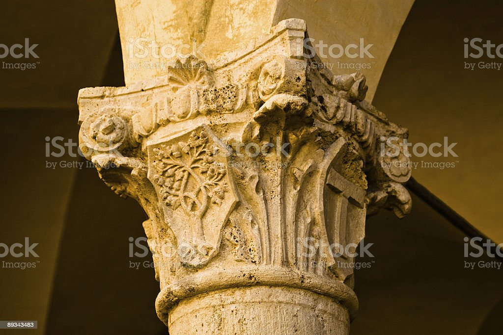 Column capital with a carved coat of arms royalty-free stock photo