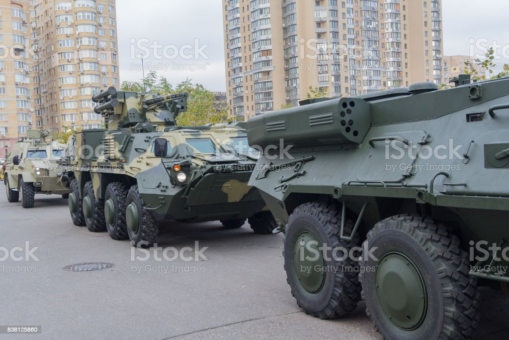 Column of armored personnel carriers on the street near the exhibition center stock photo