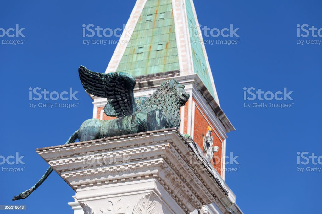 Column of San Marco and St Mark's Campanile on Piazza San Marco , Venice, Italy. stock photo