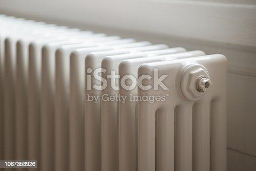White five column central heating radiator. Elegant modern version of traditional radiator, installed in Georgian house.