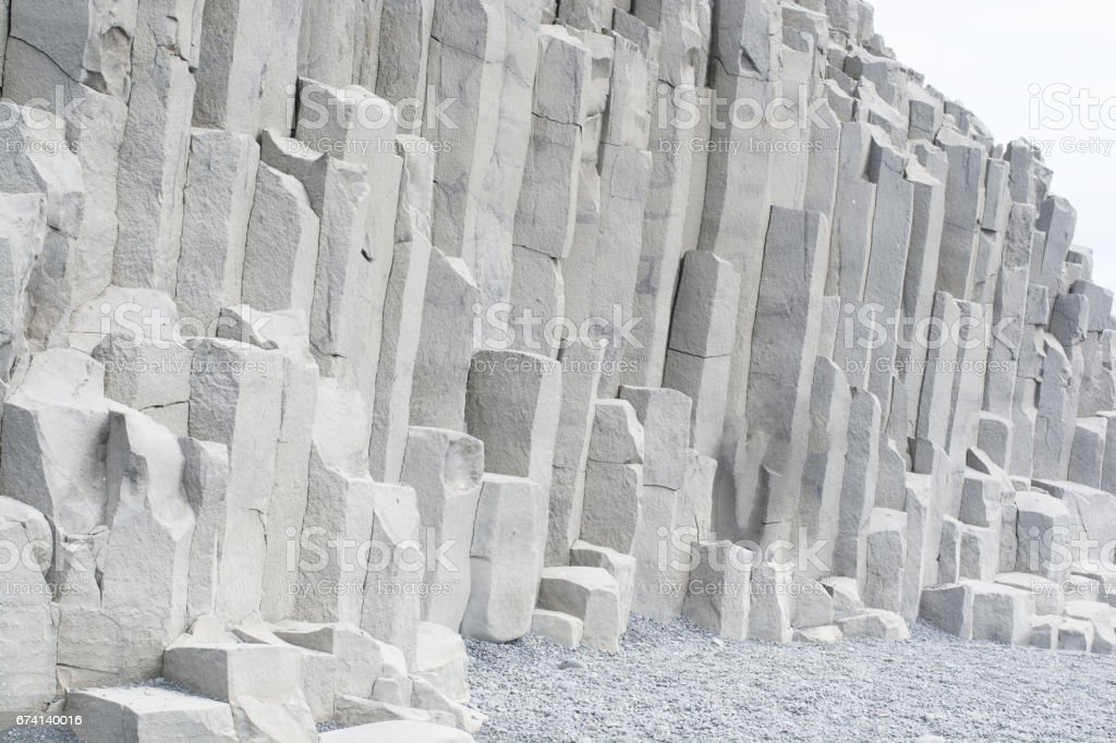 Columnar Jointing Rocks on Oceanfront at Iceland'sBlack Sands Beach stock photo