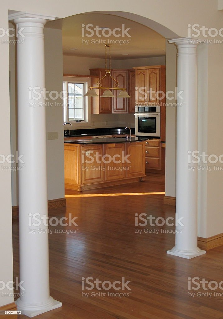 Columned archway between dining room and kitchen 免版稅 stock photo