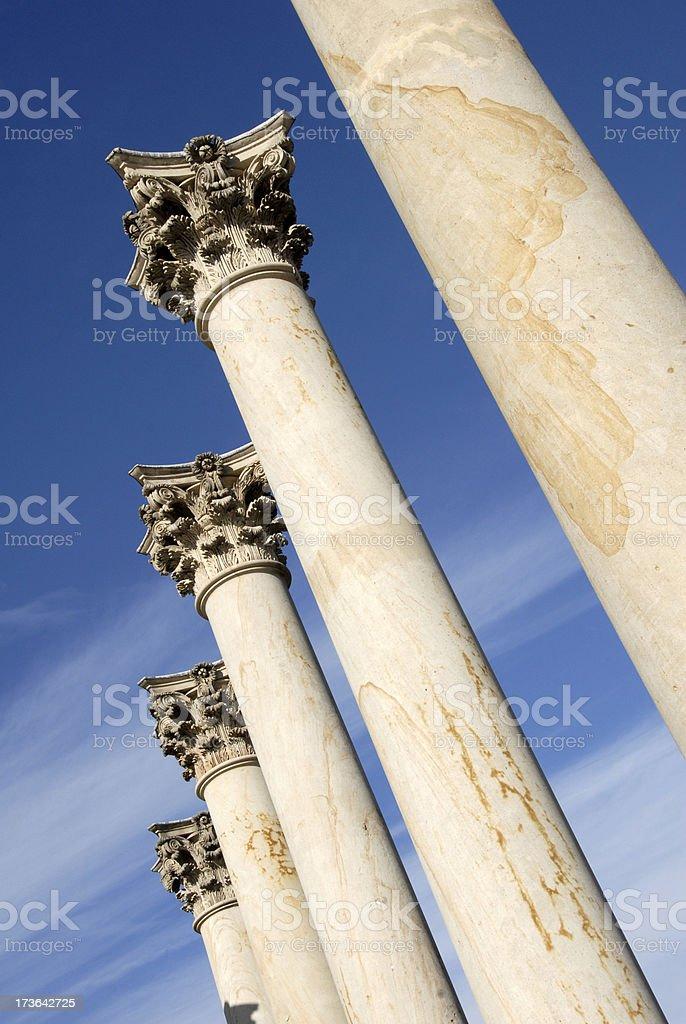 Columns against a blue sky stock photo