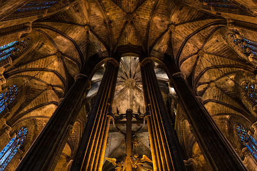 Columns and arches inside Barcelona gothic Cathedral