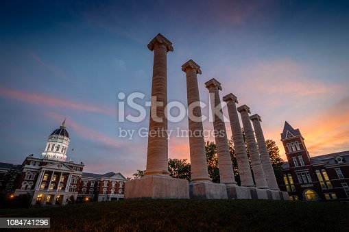 Architectural columns and Jesse Hall on the campus of University of Missouri. University of Missouri campus at sunset.