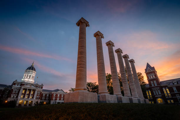 Columns at University of Missouri Architectural columns and Jesse Hall on the campus of University of Missouri. University of Missouri campus at sunset. university of missouri columbia stock pictures, royalty-free photos & images