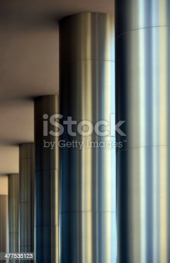 Row of columns clad in stainless steel - modern architecture