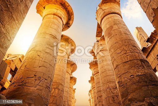 Great columns in Luxor Temple at sunrise