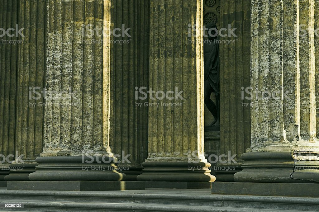 Columns of Ancient Cathedral and Sculpture stock photo
