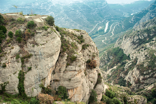 Columns of conglomerate rock stand out against the landscape at Montserrat, Spain