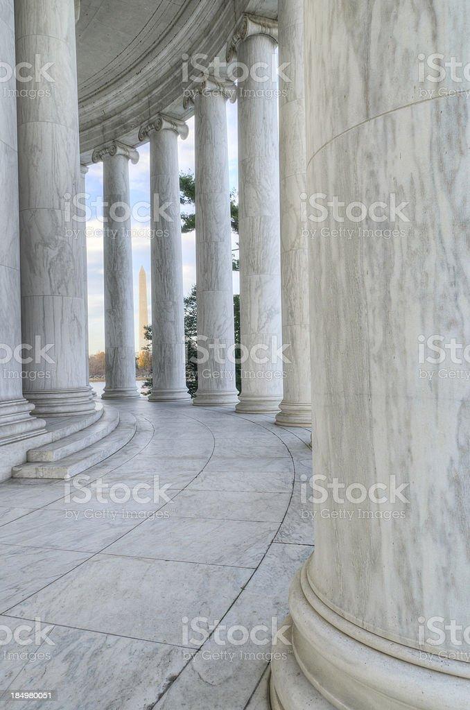 Columns of the Jefferson Memorial framing Washington Monument stock photo