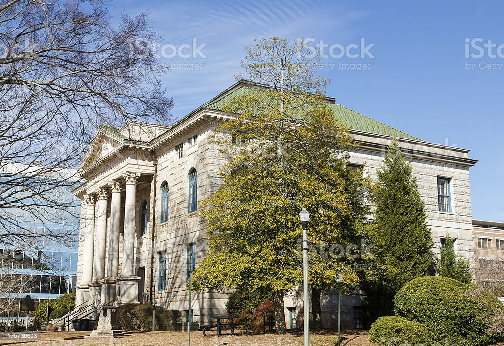 Columns on Old Stone Courthouse by Trees royalty-free stock photo