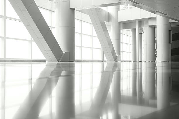 Columns Reflection Light shining through the windows and columns of a modern architecture, with reflections on the floor. arch architectural feature stock pictures, royalty-free photos & images