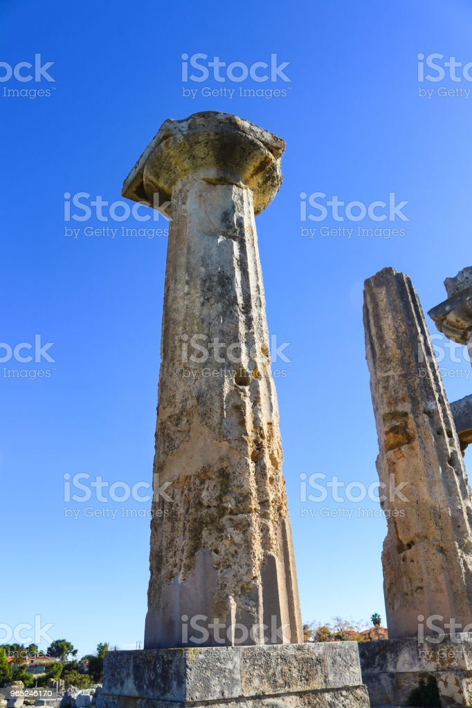 Columns towering up into a blue sky at archeological site at ancient Corinth Greece zbiór zdjęć royalty-free