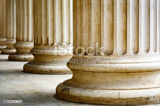 istock Columns with base and flute on a sun light 1175280852
