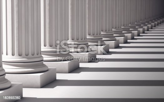 A row of columns diminishes to the vanishing point and out of focus.Computer Generated for perfect shadow angles and crisp columns.