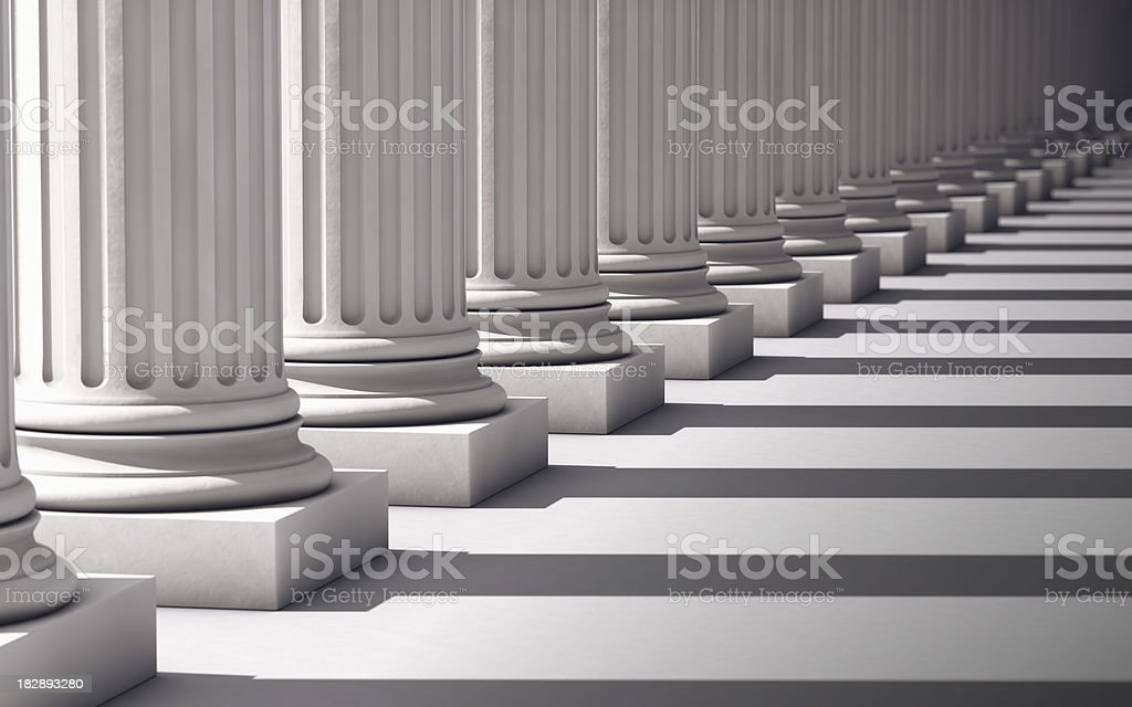 Columns with shadows deep perspective stock photo