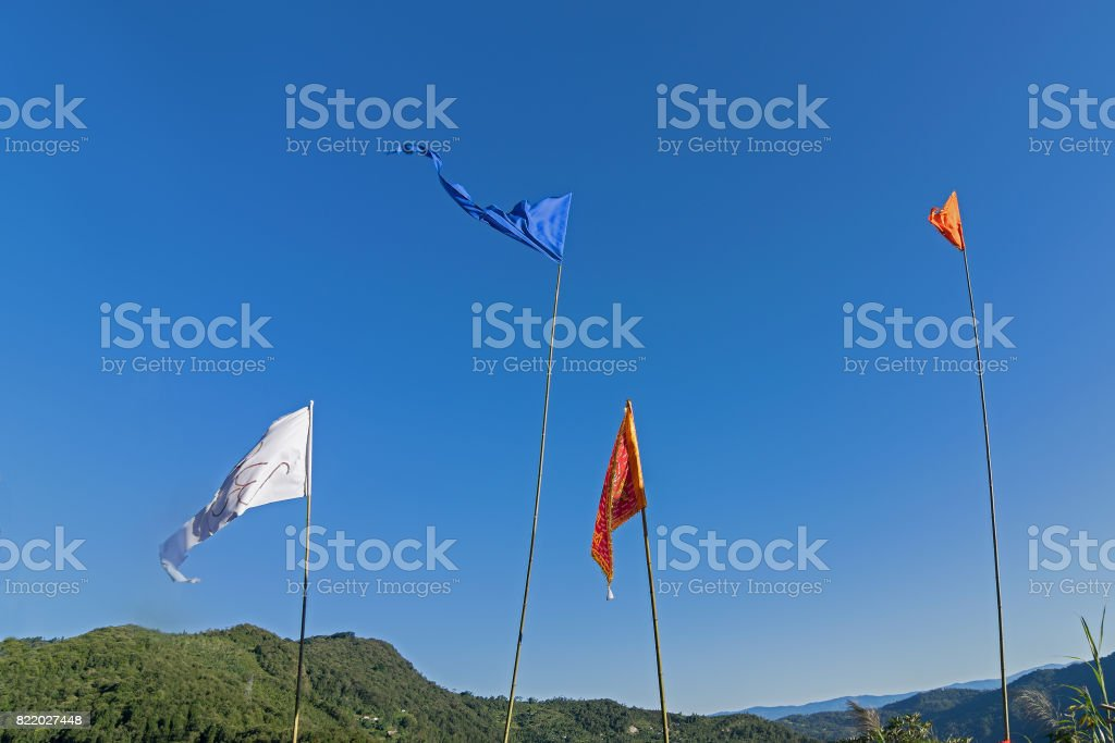 Colurful Buddhist Prayer flags flying high stock photo