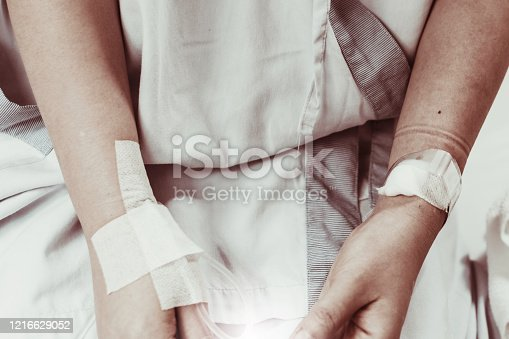 910488902 istock photo Coma patient on hopital bed take care by doctor nurse due to serious infection diagnosed cancer, coronavirus, thalassemia, aids. Need health technology treatment to recover and survive virus crisis 1216629052