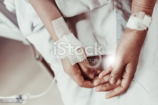 910488902 istock photo Coma patient on hopital bed take care by doctor nurse due to serious infection diagnosed cancer, coronavirus, thalassemia, aids. Need health technology treatment to recover and survive virus crisis 1216629120