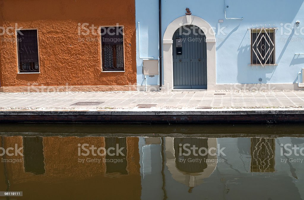 Comacchio (Ferrara) - Colorful houses reflecting in the canal royalty-free stock photo
