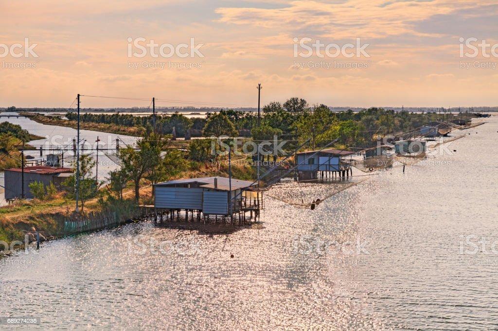 Comacchio, Ferrara, Italy: landscape of the wetland with fishing huts stock photo