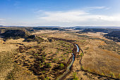 A beautiful drone photo of Comanche National Grassland.  A vast canyon filled with prehistoric artifacts