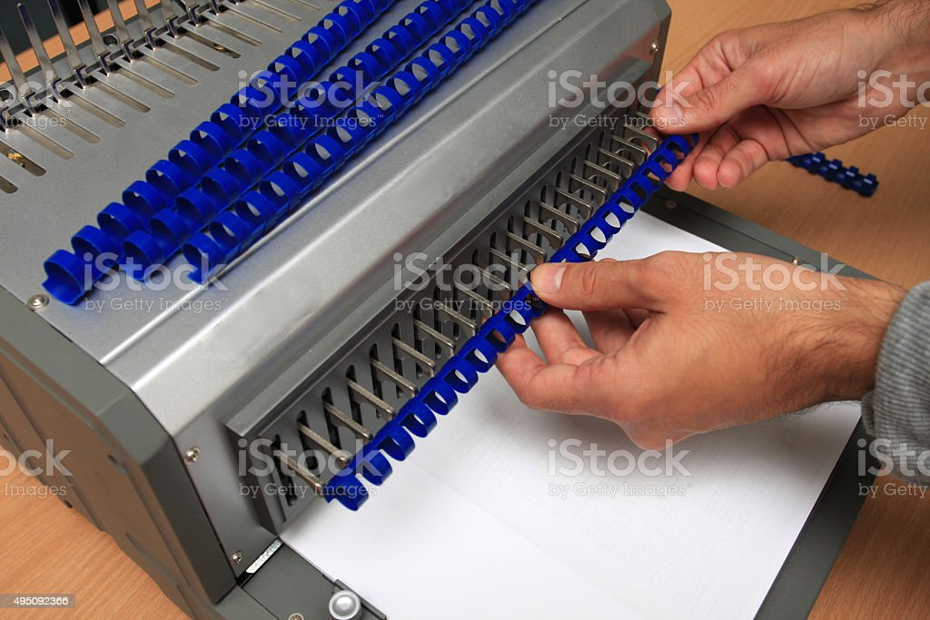 comb binder machine with clipping path stock photo