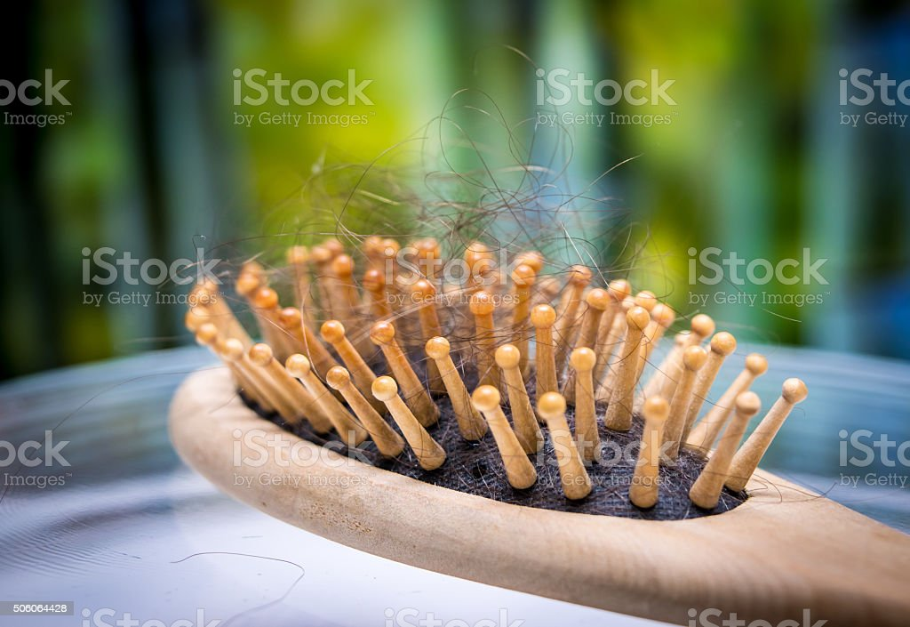 comb brush with lost hair stock photo