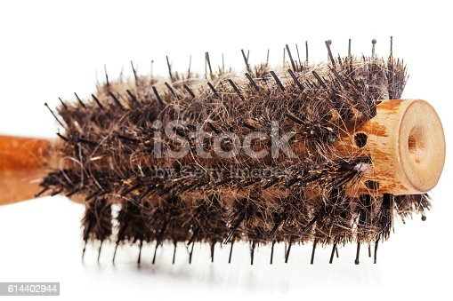 istock Comb with hair fell out. The problem with alopecia 614402944
