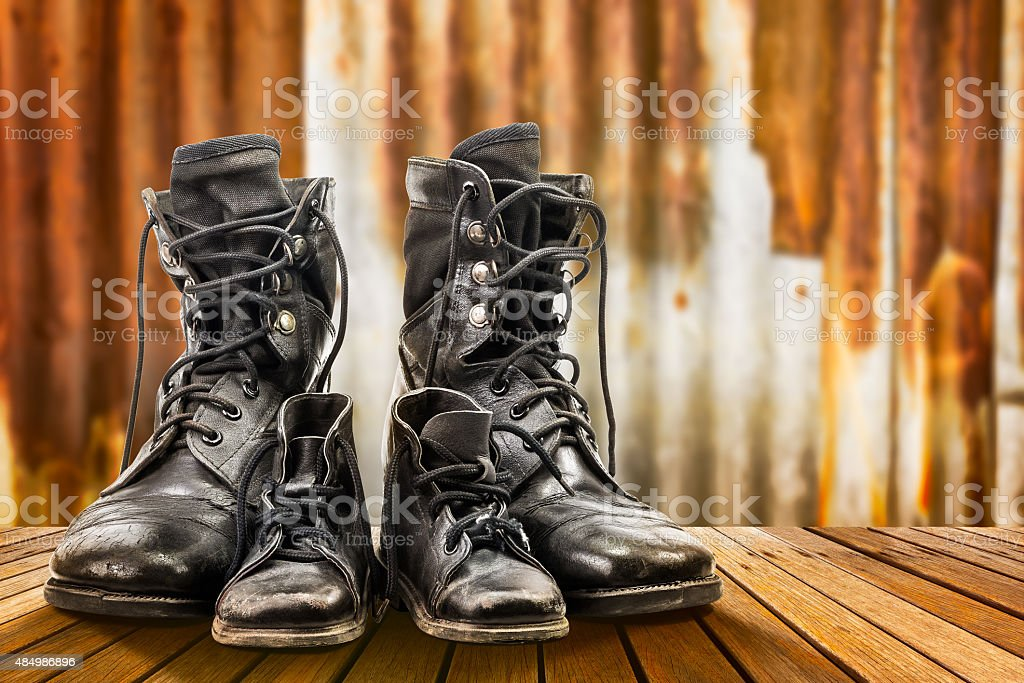 Combat boots for adult and kid stock photo