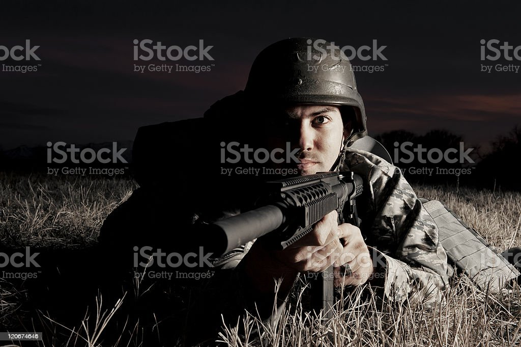 Combat position with gun in hand royalty-free stock photo