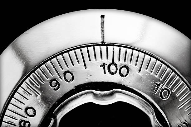 Combination lock Combination lock detail from safety box safes and vaults stock pictures, royalty-free photos & images