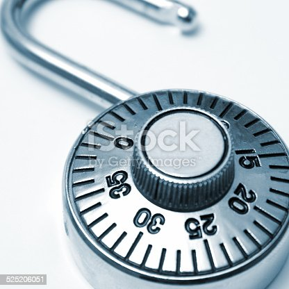 A combination lock that you would use to protect your valuables in square format and in blue tint.