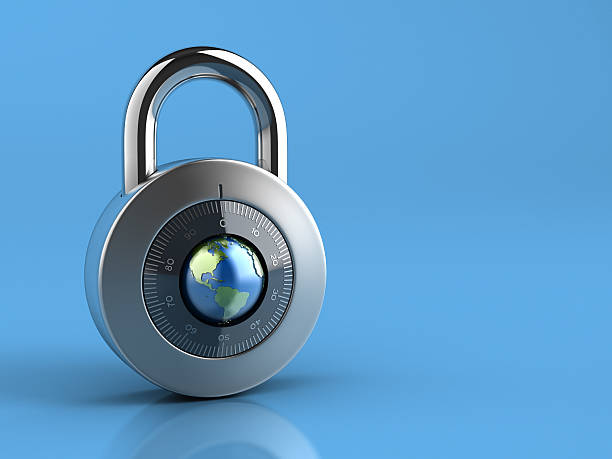 Combination Lock with globe dial on blue background stock photo