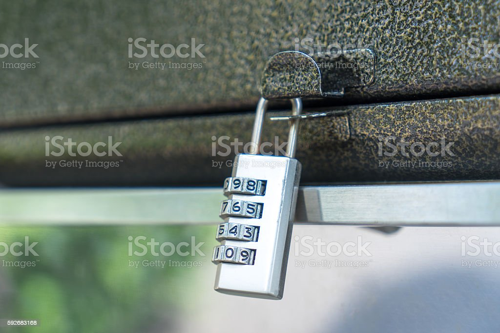 combination locker on black leather luggage stock photo