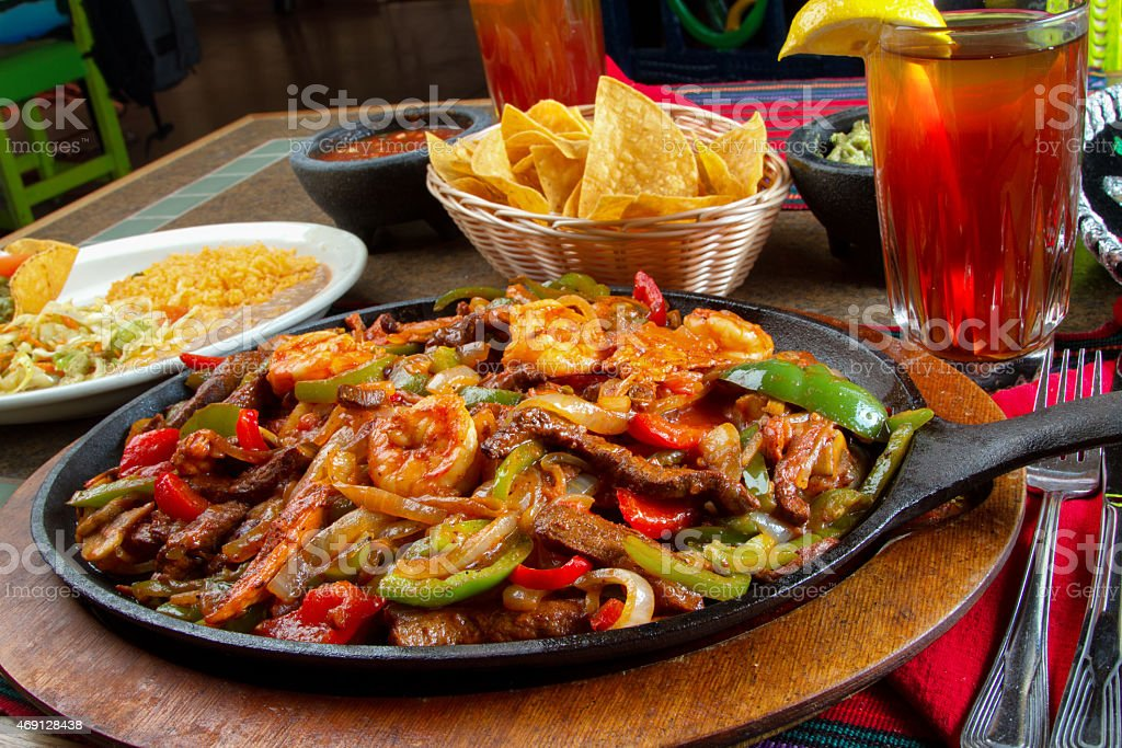 Combination Mexican Fajitas with Shrimp, Chicken and Beef stock photo