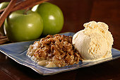 Warm apple crisp with a scoop of vanilla ice cream.