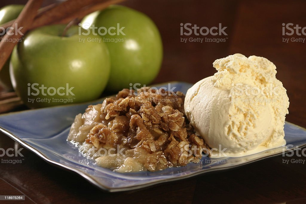 A combination of ice cream with apple crisp on it  stock photo
