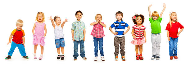 Combination of little kids standing isolated Combination of a number of divers looking little preschool children isolated on white standing preschool age stock pictures, royalty-free photos & images
