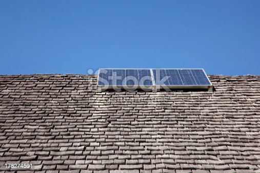 istock combination of old roof and solar energy 178274591