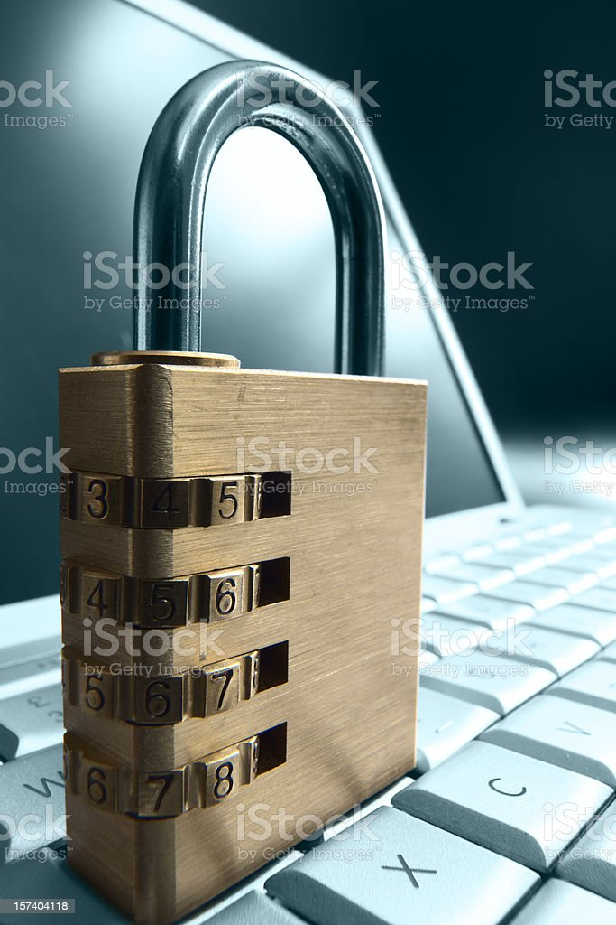 Combination Padlock on a Keyboard royalty-free stock photo
