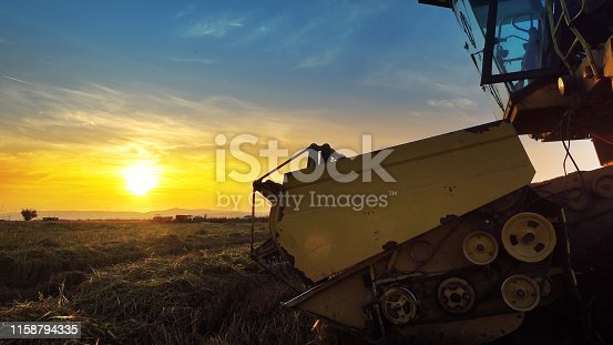 istock Combine, field and sunrise. Reach success in agribusiness 1158794335