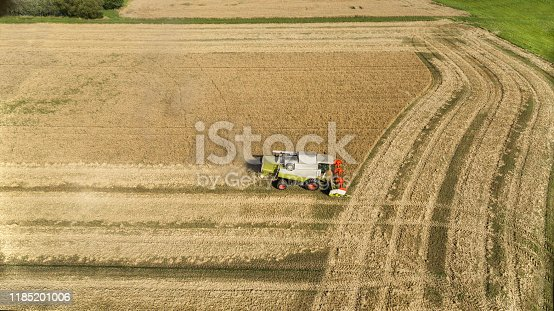 Big old combine harvester harvesting, aerial view